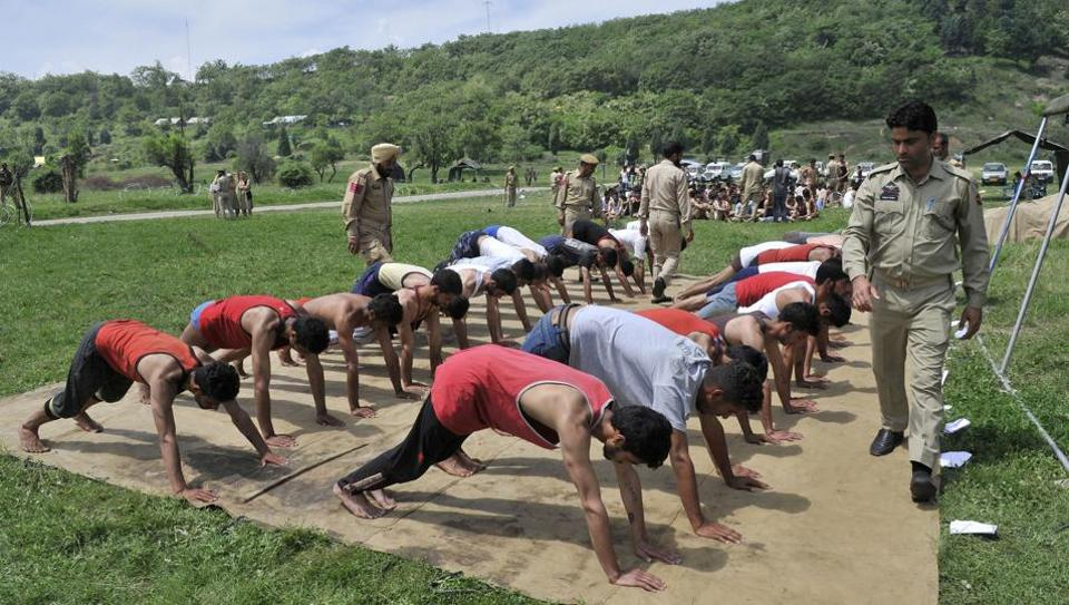 Youth undergo physical endurance tests in the Kashmir Police recruitment drive in Anantnag on Friday.