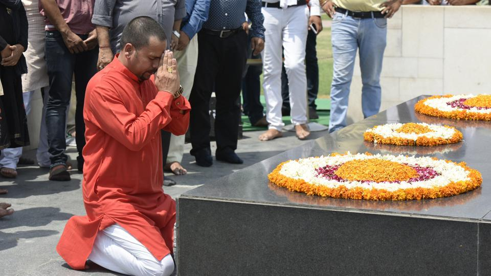 Sanjay Jha visits Rajghat before staging a counter hunger strike against Kapil Mishra in New Delhi on Saturday.