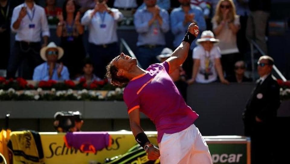 Rafael Nadal celebrates his victory after beating Novak Djokovic in the Madrid Open on Saturday.