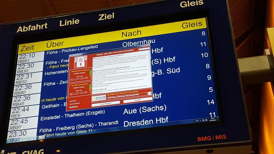A window announcing the encryption of data including a requirement to pay appears on an electronic timetable display at the railway station in Chemnitz, eastern Germany, on May 12.