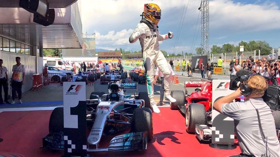 Lewis Hamilton celebrates after winning the Spanish F1 Grand Prix in Barcelona.