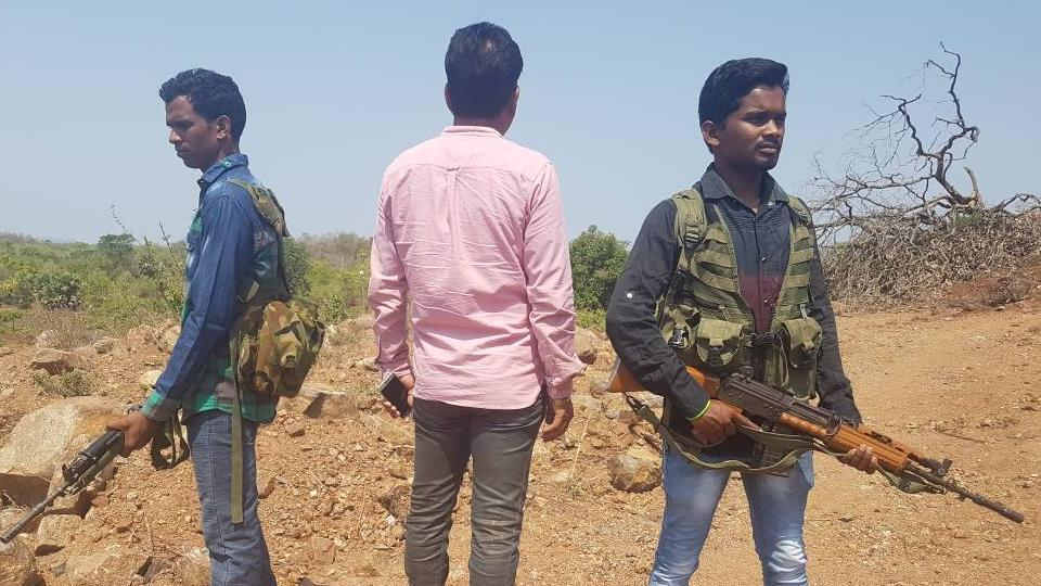 Pramod Rathore, whose work is fraught with danger, moves around with gun-toting bodyguards in Chhattisgarh.