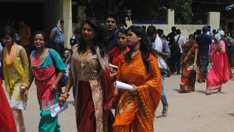 CLAT examinees coming out of an examination centre in Patna, on Sunday.