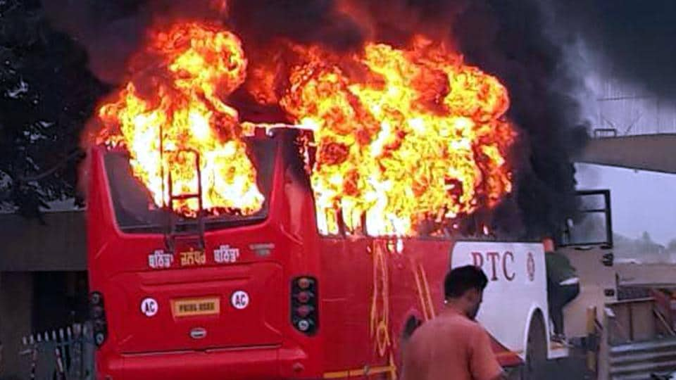 The bus on fire in Rampura Phul near Bathinda on Saturday, May 13.