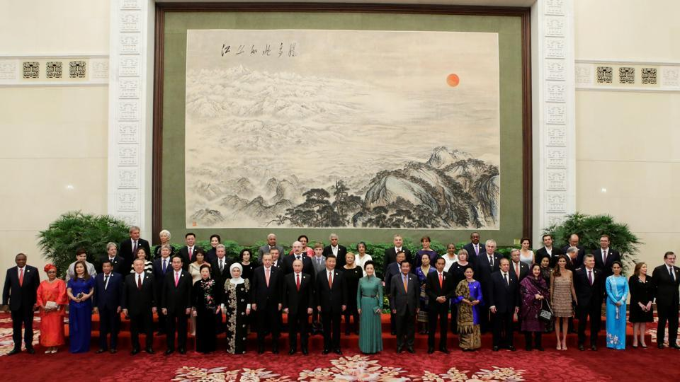 Chinese President Xi Jinping poses for a group photo with other delegates and guests at the welcoming banquet for the Belt and Road Forum in Beijing on Sunday.