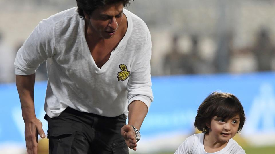 Shah Rukh Khan, Bollywood actor and co-owner of Kolkata Knight Riders (KKR), with his son AbRam play at EdenGardens after the Indian Premier League (IPL) match between KKR and Mumbai Indians (MI)on Saturday.