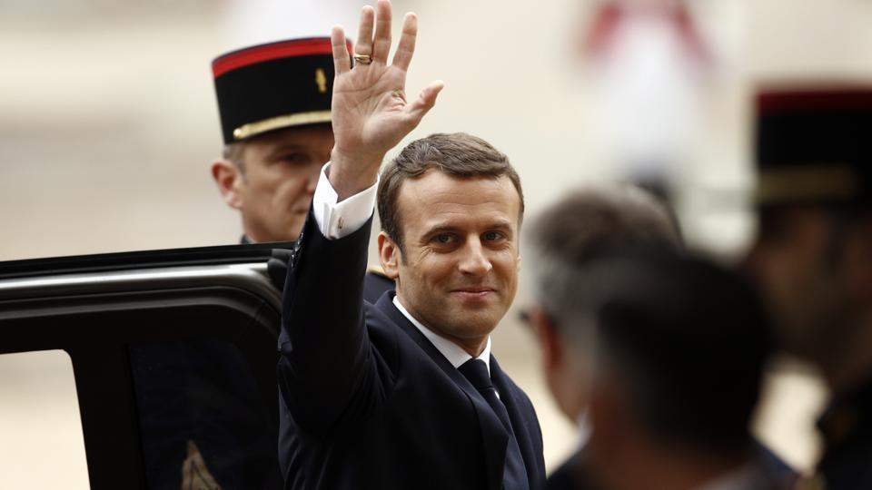 Incoming French President Emmanuel Macron waves to the crowd before his inauguration ceremony as French President, at the Elysee Palace on Sunday in Paris.