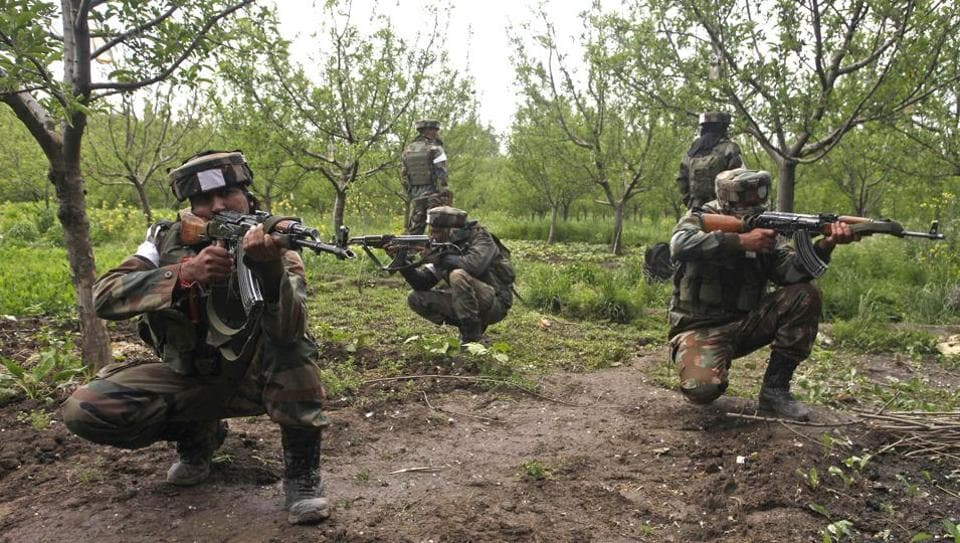 Army soldiers take position during an operation against militants in Shopian district, south of Srinagar, on May 4, 2017. The army said they were alerted to the presence of at least 100 militants in the area and have been on alert.