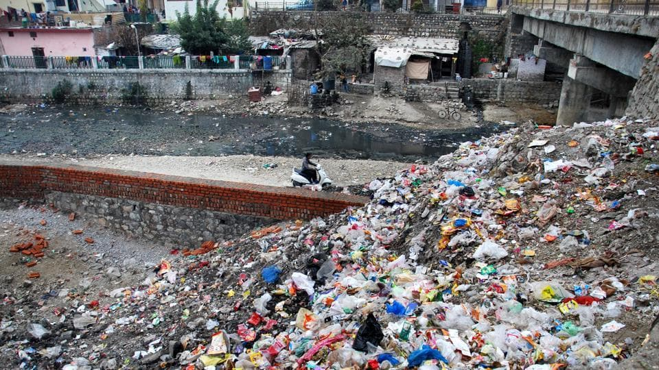 A heap of garbage dumped next to a stream in Dehradun, which has been ranked at a dismal 316th position in the Swachh Survekshan 2017 survey.