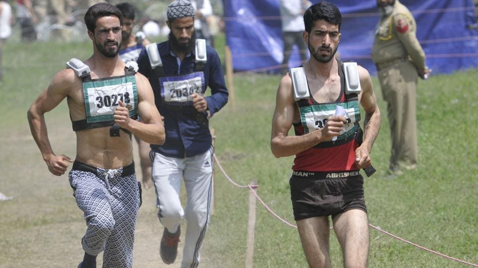 Young men undergo physical endurance test in the Kashmir Police recruitment drive in Anantnag on Saturday.