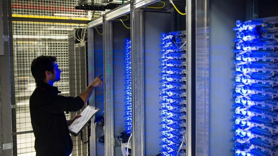 An employee of Equinix data center checking servers on July 21, 2014 in Pantin, a suburb north of Paris in the Seine-Saint-Denis department.