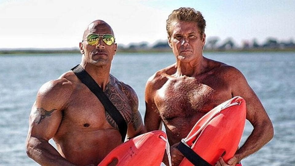 David Hasselhoff (R) poses with Dwayne Johnson on the sets of Baywatch.