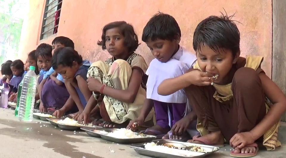 Children having midday meal at a primary school in Bihar's Araria district.