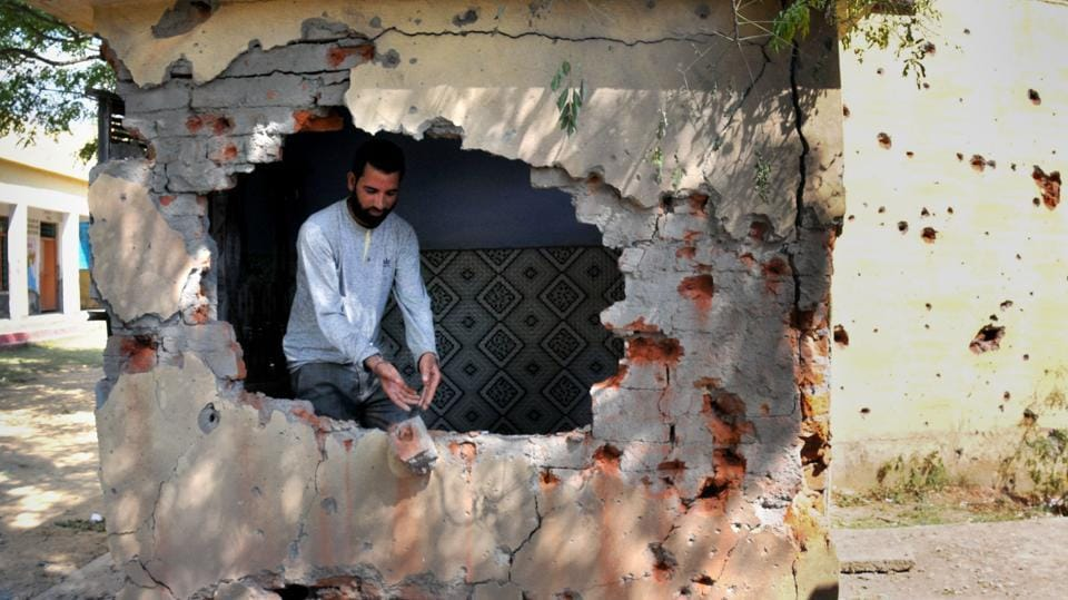 A civilian inspects a damaged building by mortar shells at Jhanghar village in Nowshera. Villagers along India-Pakistan border in Jammu and Kashmir are suffering the brunt of cross-border firing with the neighbouring countries continuing to violate ceasefire agreement. (Nitin Kanotra  / HT Photo)