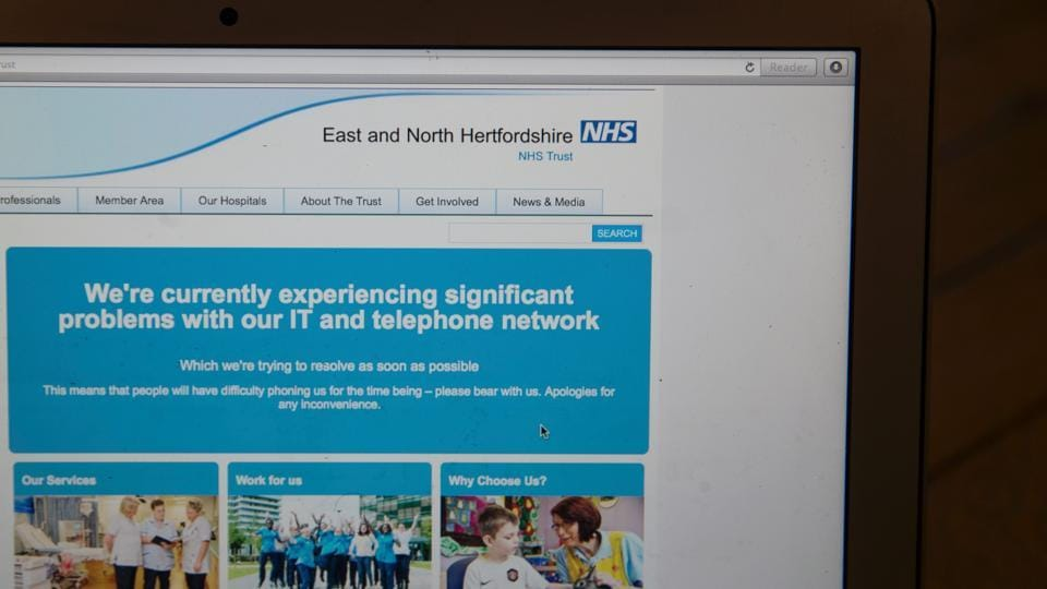 This photograph, posed as an illustration on May 12, 2017, shows the website of the NHS: East and North Hertfordshire notifying users of a problem in its network taken in London.