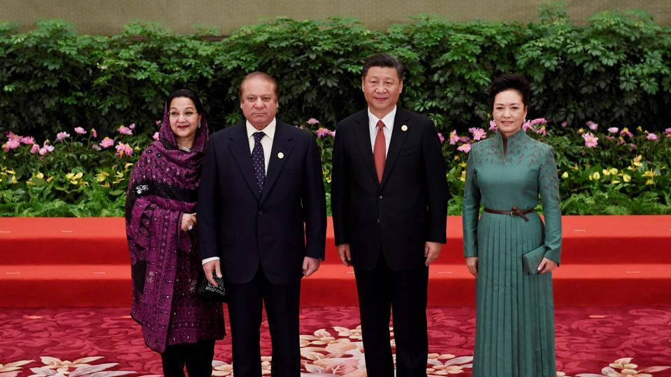 Pakistan's Prime Minister Nawaz Sharif (2ndL) and his wife Kalsoom Nawaz Sharif (L) pose with Chinese President Xi Jinping and his wife Peng Liyuan (R) during a welcome ceremony for leaders attending the Belt and Road Forum, in Beijing's Great Hall of the People on Sunday.