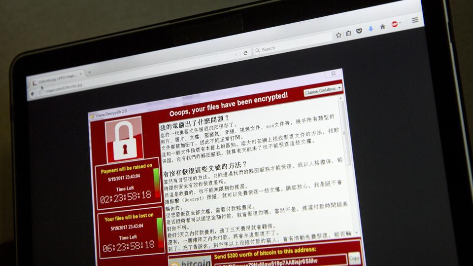 A screenshot of the warning screen from a purported ransomware attack, as captured by a computer user in Taiwan, is seen on laptop in Beijing on Saturday. Dozens of countries were hit with a huge cyber-extortion attack Friday that locked up computers and held users' files for ransom at a multitude of hospitals, companies and government agencies.