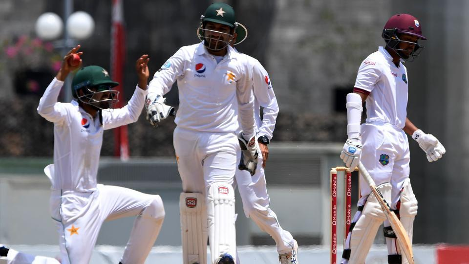 Babar Azam (L) of Pakistan cricket team celebrates after taking the catch to dismiss West Indies cricket team batsman Vishaul Singh (R) off the bowling of Yasir Shah on the fifth day of the third and final Test at Windsor Park Stadium in Roseau, Dominica, on Sunday. Get full cricket score of West Indies vs Pakistan 3rd Test, Day 5, here.