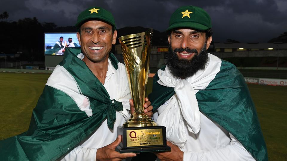 Retiring Pakistan cricket team members Younis Khan (left) and captain Misbah-ul-Haq celebrate with the series trophy after winning the final Test match and the series 2-1 against the West Indies at the Windsor Park Stadium in Roseau, Dominica on Sunday.