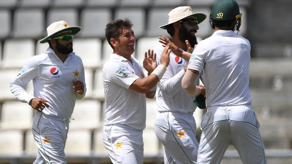 Yasir Shah of Pakistan cricket team (2nd L) celebrates with teammates after taking the wicket of West Indies cricket team batsman Kraigg Brathwaite, who was caught by Hasan Ali for 6 on the fifth day of the third and final Test at Windsor Park Stadium in Roseau, Dominica, on Sunday.