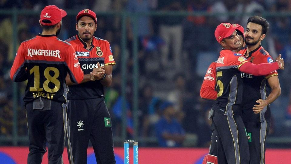 Royal Challengers Bangalore bowler Harshal Patel (R) celebrates with teammates after taking the wicket of Delhi Daredevils batsman Rishab Pant (not in picture) during their 2017 Indian Premier League match on Sunday.
