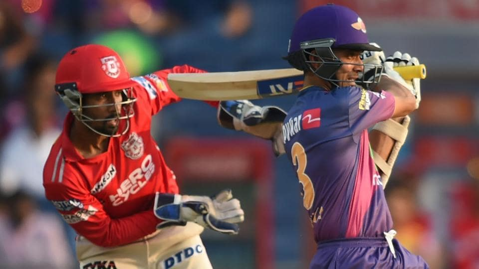 Rising Pune Supergiant (RPS)batsman Ajinkya Rahane hits a pull shot for a boundary as Kings XI Punjab wicketkeeper Wriddhiman Saha (L) looks during their Indian Premier League (IPL) match onSunday. Get final IPL 2017 standings (after the league phase) here.