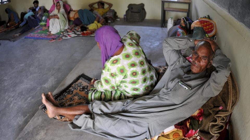 Evacuated villagers seen at a relief camp set up at a  government school, along the highly militarized Line of Control that divides the region between India and Pakistan in Nowshera.