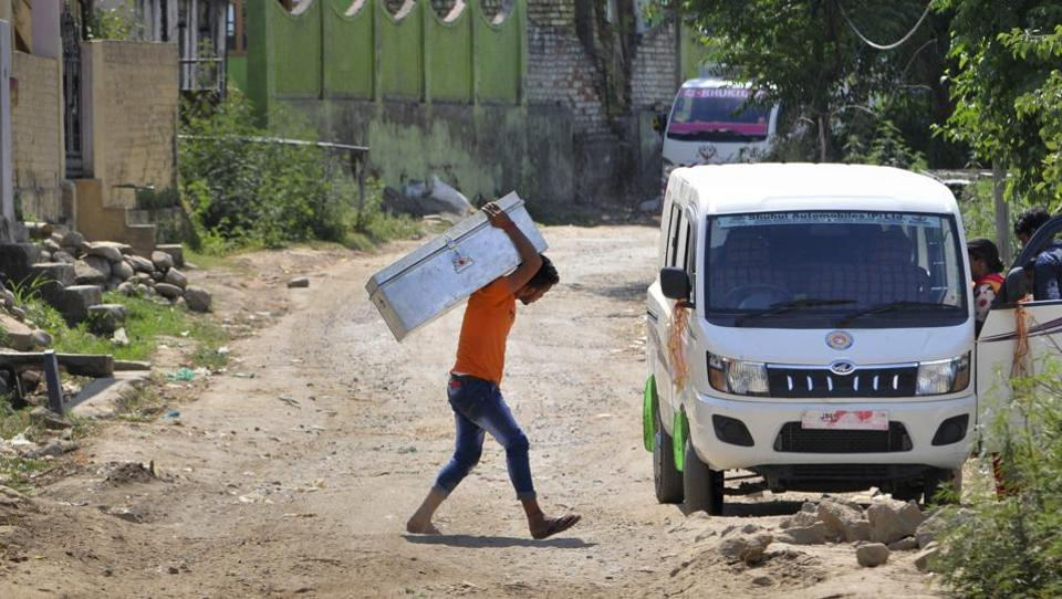 Jhangar villagers take their belongings with them while moving to safer places following cross-border firing in Nowshera.