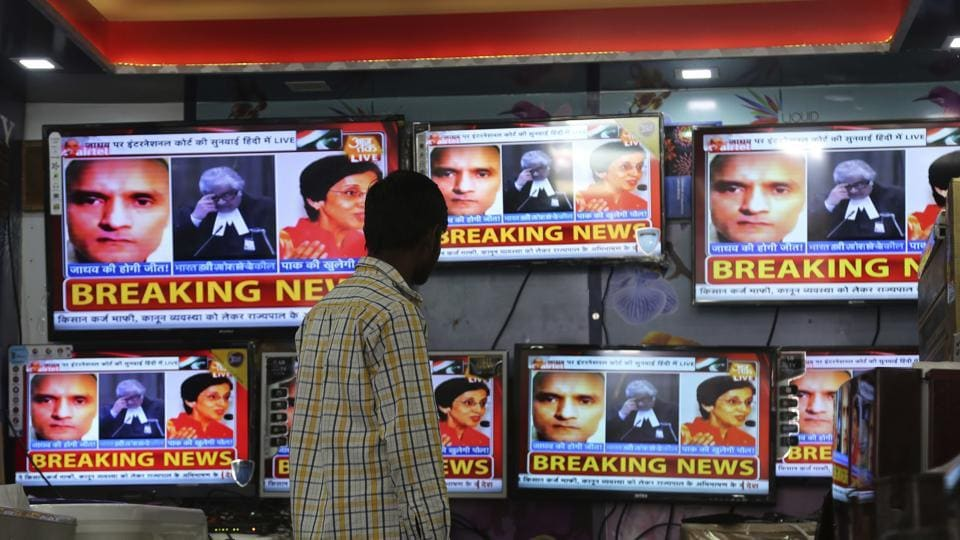 Television channels show news about the ICJ hearing on Kulbhushan Jadhav's death sentence.