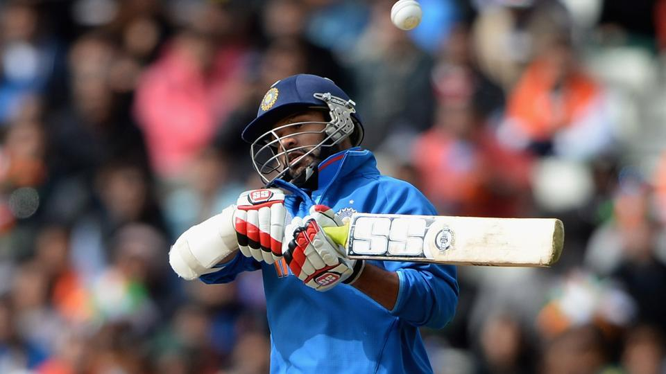 Shikhar Dhawan of India avoids a short ball from Mohammad Irfan of Pakistan during the ICC Champions Trophy match at Edgbaston on June 15, 2013 in Birmingham, England.