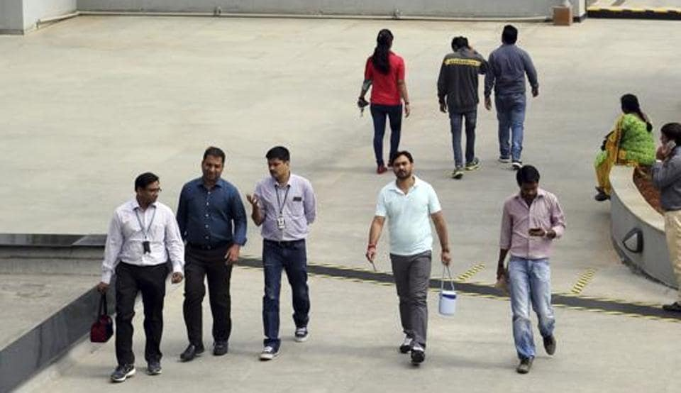 Wipro Ltd. employees walk inside the company's compound at their headquarters in Bangalore.