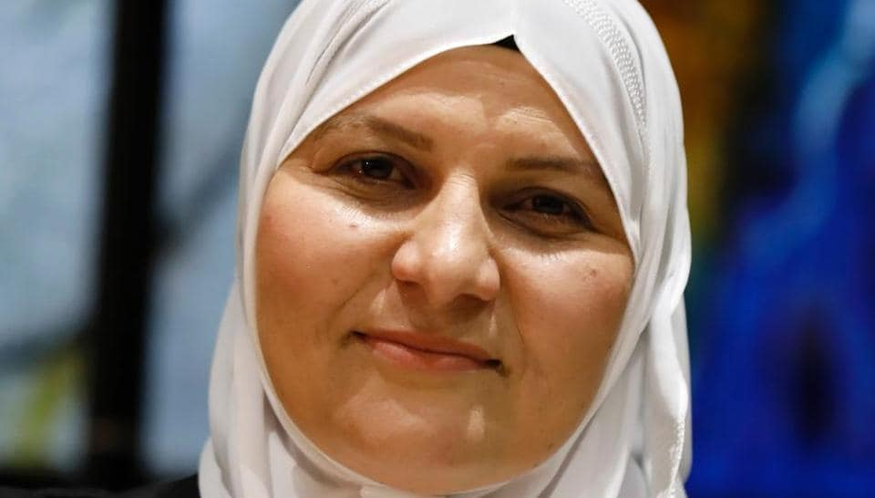 Israeli Muslim Hana Khatib, the first woman in Israel to be appointed by an Israeli justice committee to become a religious judge in the courts ruling on personal law for Muslims poses for a photo on May 15.