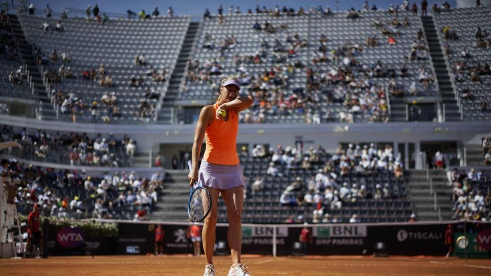 Maria Sharapova of Russia wipes sweat form her face during her match against Christina Mchale of the United States at the Italian Open in Rome on Monday.
