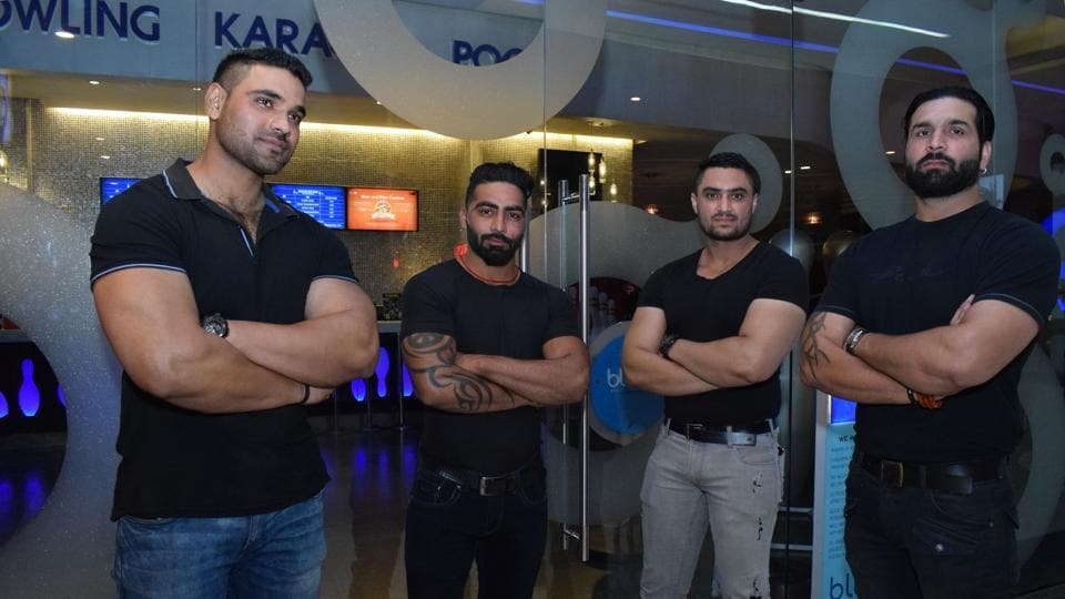 Bouncers outside a night club at a mall in Chandigarh.