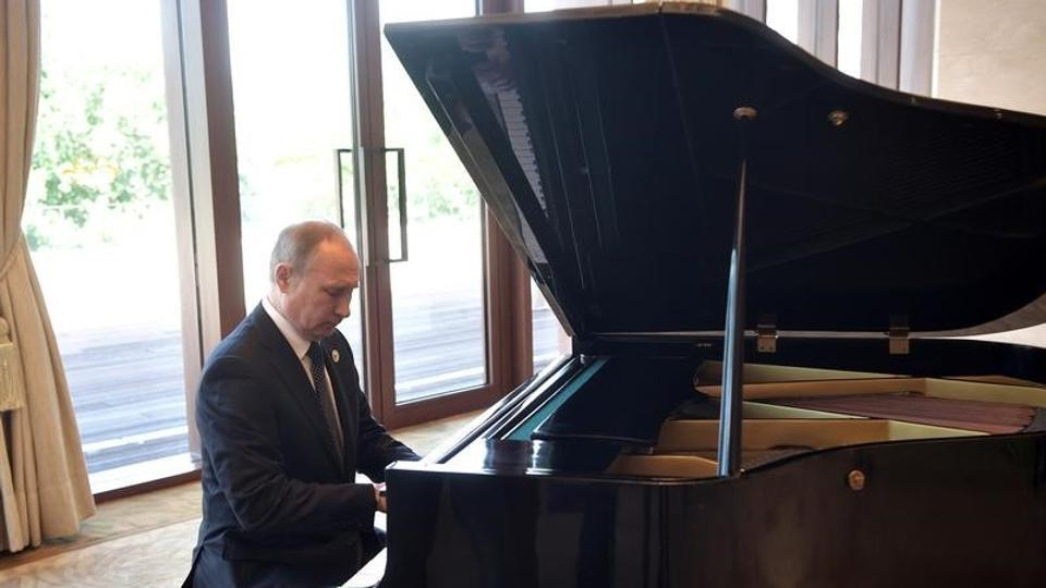 Russian President Vladimir Putin plays piano before meeting Chinese leader Xi Jinping on the first day of the Belt and Road Forum in Beijing on Sunday.