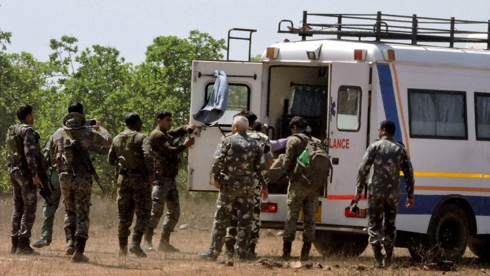 CRPF personnel around an ambulance at an encounter site in Jamshedpur.