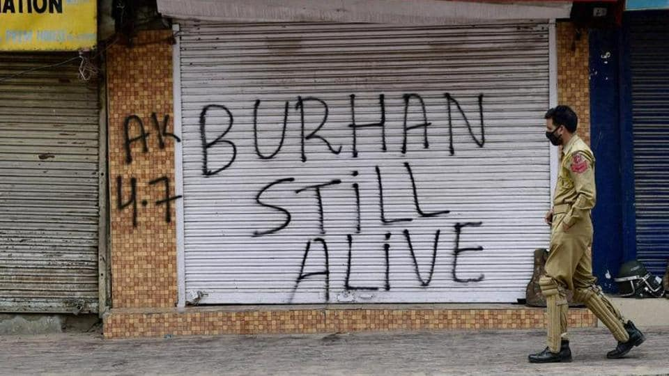 A policeman walks through a deserted street in Srinagar during a strike declared by separatists recently. Zakir Musa took over the reins of the Hizbul Mujahideen in Kashmir after the encounter killing of Burhan Wani by security forces last year.