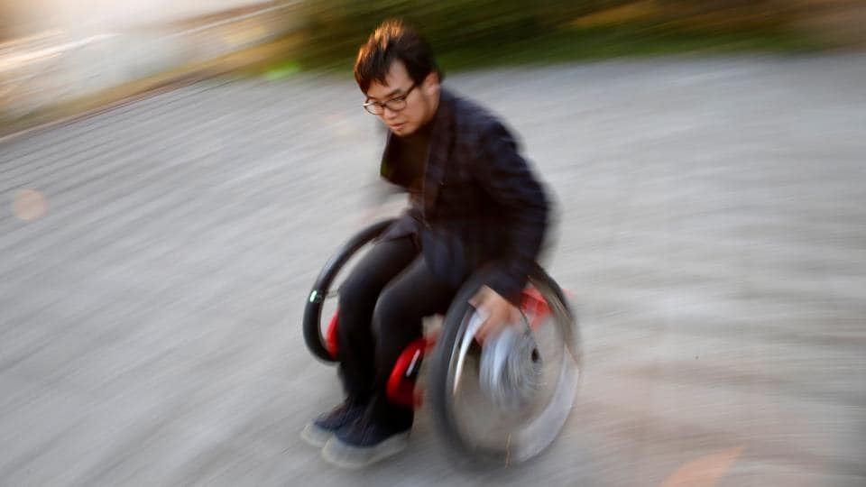 Isao Uebayashi, 38, a sports science researcher and an inventor of 'Slide Lift', demonstrates with a motor-assisted wheelchair in Tokyo, Japan. Equipped with special wheels, the motor-assisted wheelchair can be moved by 'Slide Lift' racers in any direction, including in racing car-like drifts. E Technology can improve and supplement human ability,' said Uebayashi. ' Anyone can do 'drift racing' with this wheelchair.' (Kim Kyung-Hoon / Reuters)