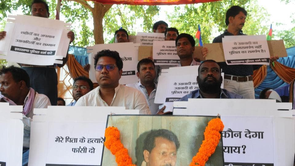 MLA Vikas Singh Munda (left in white shirt)sitting on dharna demanding hanging of  hard core Maoist Kundan Pahan who allegedly killed his father former Tamar MLA Ramesh Singh Munda in the year 2008.