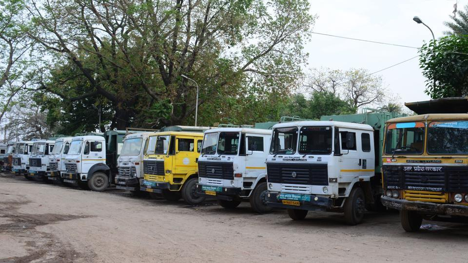 Fleet of garbage transporting trucks in Allahabad Municipal Corporation's workshop in Karelabagh area of the city.
