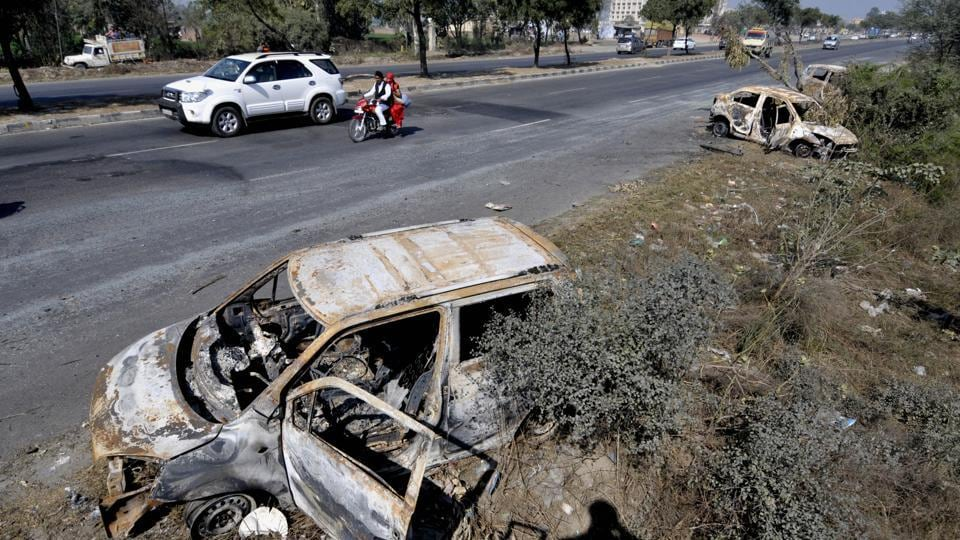 Damaged cars on national highway 1, at Murthal town near Sonipat in Haryana on February 23, 2016.