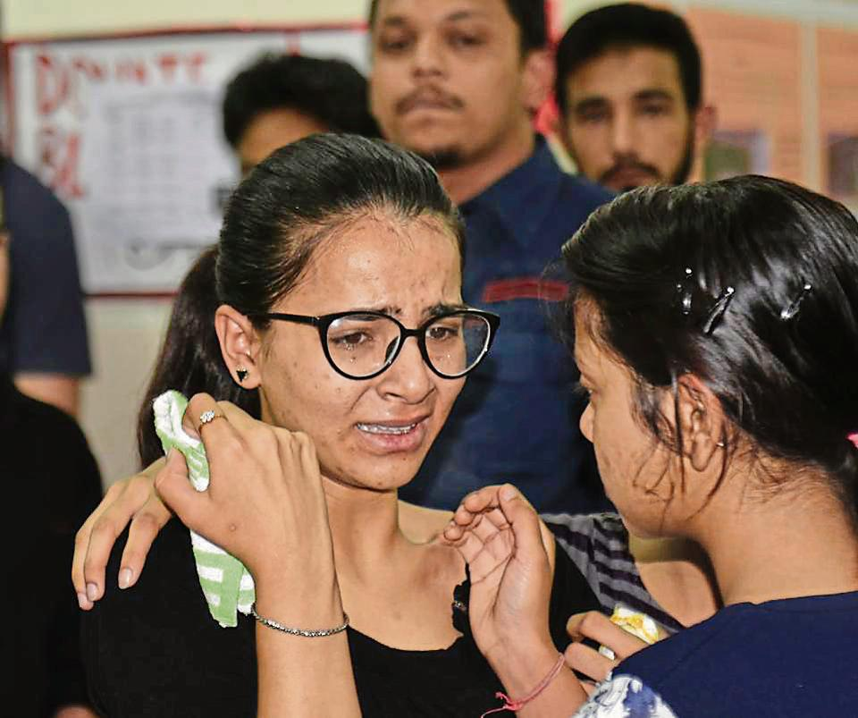 Deceased Ritu Singh's best friend Sakshi during a condolence meeting at their college in Rohini in New Delhi on Tuesday.