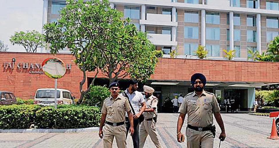 Police officials coming out after investigation from Hotel Taj in Chandigarh on Tuesday.