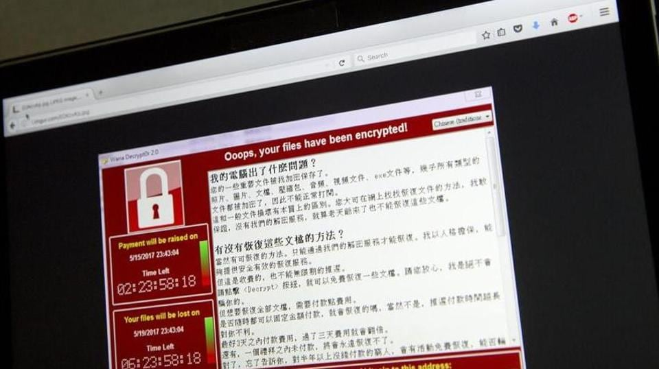 A screenshot of the warning screen from a purported ransomware attack, as captured by a computer user in Taiwan, is seen on laptop in Beijing.
