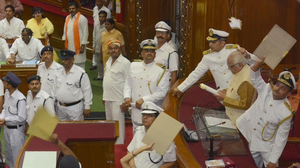 Samajwadi Party members throw paper balls at Uttar Pradesh governor Ram Naik on the first day of the state assembly session in Lucknow, May 15