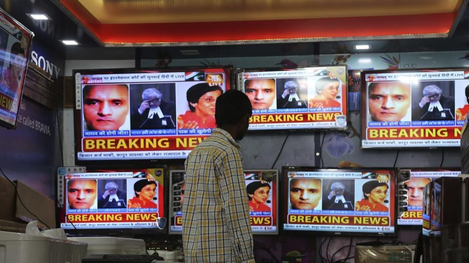 A boy watches as television channels show news about International Court of Justice hearing the case of Indian naval officer Kulbhushan Jadhav at a shop in Jammu on Monday.