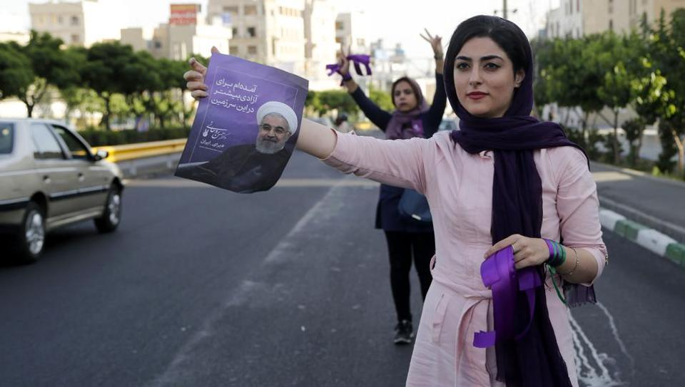 Supporters of Iranian President and presidential candidate Hassan Rouhani campaign for him in the capital Tehran on May 15, 2017.