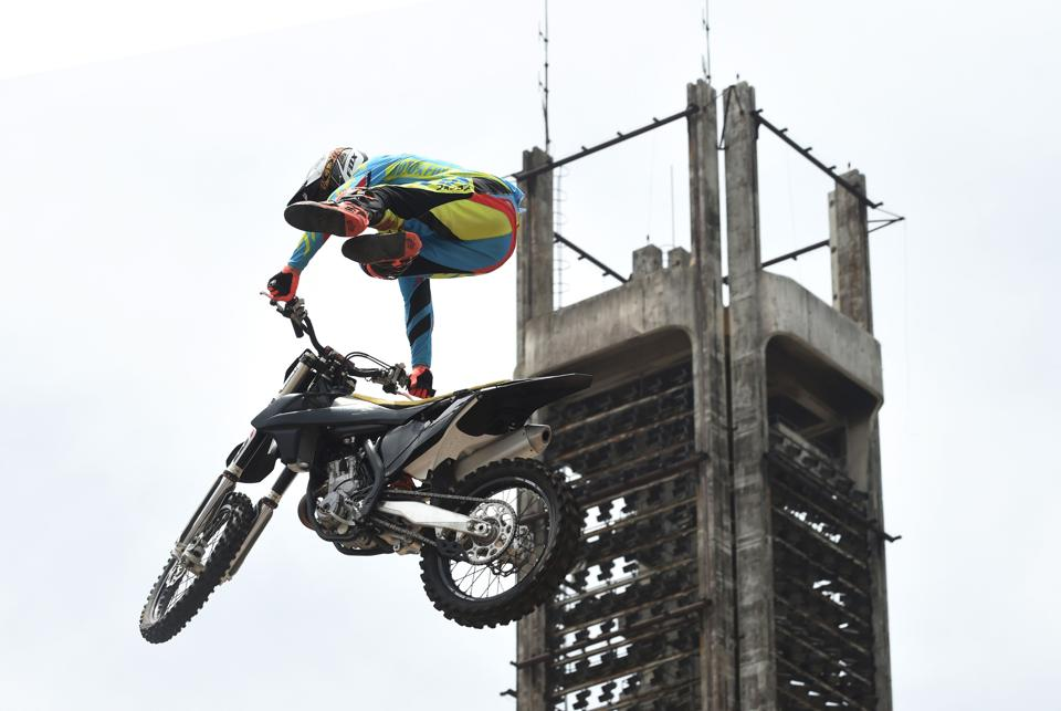 A South African freestyle motor cross rider performs during a carnival to mark 50 month-long celebrations. (PIUS UTOMI EKPEI / AFP)