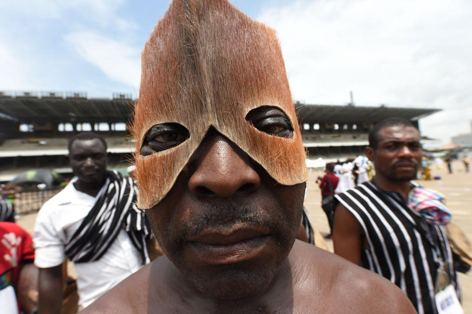 A man wearing a mask made from animal skin from Benue State in northcentral Nigeria performs during a carnival . (PIUS UTOMI EKPEI / AFP)