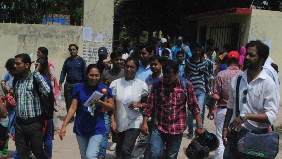 CLAT aspirants coming out of an examination centre, in Patna on Sunday.
